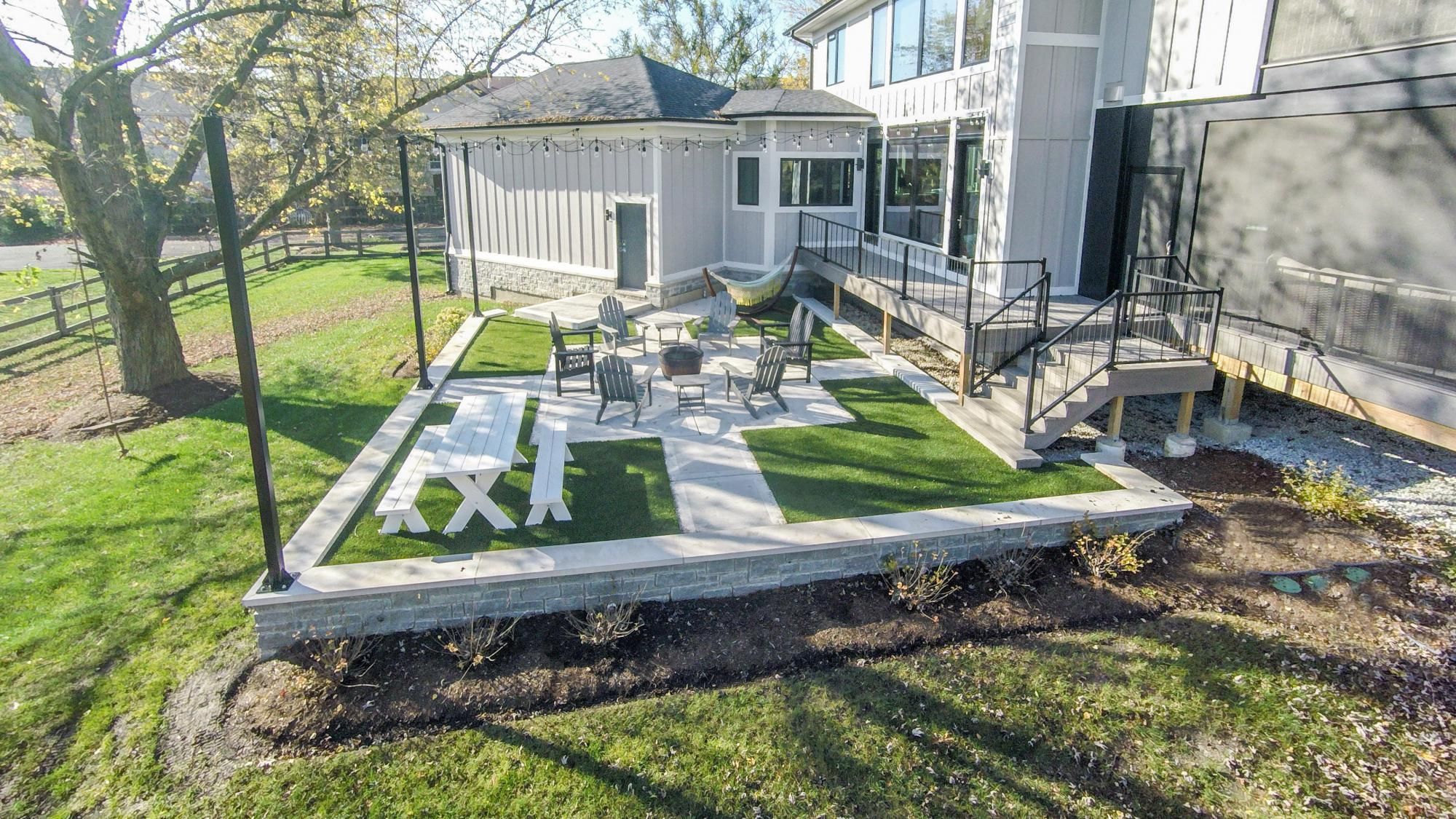 ... Unique Back Patio Design With Permeable Astroturf Inserts