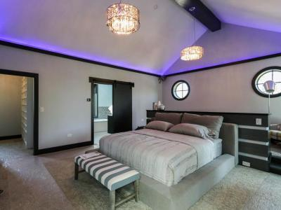Master Bedroom With Accent Mood Lighting And Elevated Seating Area