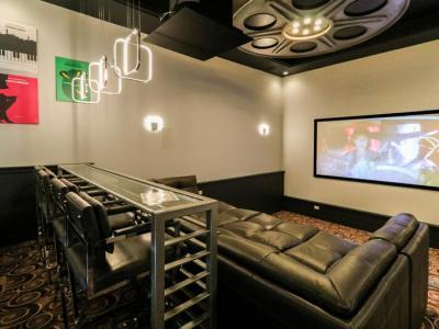 Home Theater With Comfortable Three Level Seating And Bar Seating