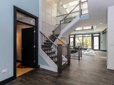 Foyer And Two Story Atrium In DJK Modern Farm House