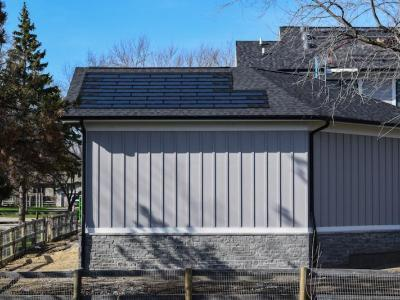 DOW Powerhouse Solar Shingles Installed Above Garage