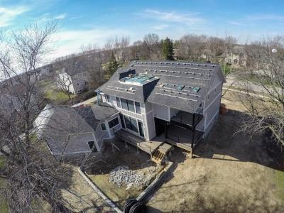 Bracket Installation For Suniva Solar Panels And Dow Powerhouse Solar Shingles On Modern Farm House Eco-Smart Home