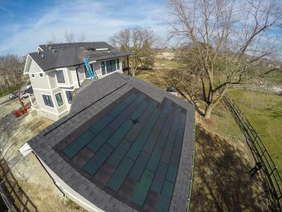 DOW Powerhouse Solar Shingles Installed Above Garage On Modern Farm House Eco-Smart Home